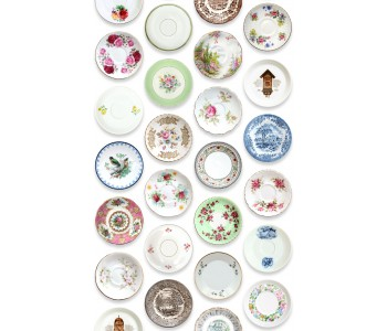 Colorful porcelain tableware on wallpaper