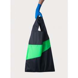 Nylon shopping bag by Susan bijl in black and bright green
