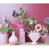 Allerlei schattige vaasjes in roze bij shop.holland.com