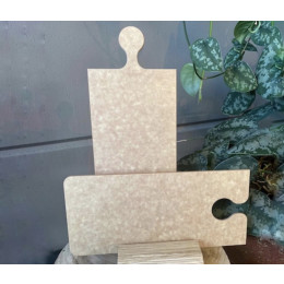 Puzzleboard OOOMS a cheese board in the shape of a jigsaw puzzle piece