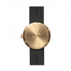 Back side of D38 Tube watch in brass with brown leather strap by Piet Hein Eek for LEFF Amsterdam